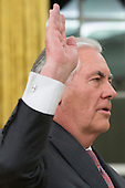 Rex Tillerson is sworn-in as Secretary of State in the Oval Office of the White House in Washington, DC, USA, 01 February 2017. Tillerson was confirmed by the Senate, 01 February, in a 56-to-43 vote to become the nation's 69th Secretary of State.<br /> Credit: Michael Reynolds / Pool via CNP