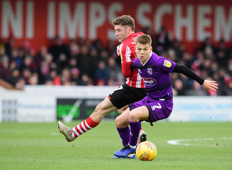 Grimsby Town's Jake Hessenthaler shields the ball from Lincoln City's Shay McCartan<br /> <br /> Photographer Chris Vaughan/CameraSport<br /> <br /> The EFL Sky Bet League Two - Lincoln City v Grimsby Town - Saturday 19 January 2019 - Sincil Bank - Lincoln<br /> <br /> World Copyright &copy; 2019 CameraSport. All rights reserved. 43 Linden Ave. Countesthorpe. Leicester. England. LE8 5PG - Tel: +44 (0) 116 277 4147 - admin@camerasport.com - www.camerasport.com