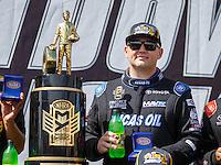 Sep 18, 2016; Concord, NC, USA; NHRA top fuel driver Richie Crampton alongside the championship trophy during the Carolina Nationals at zMax Dragway. Mandatory Credit: Mark J. Rebilas-USA TODAY Sports