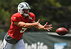 Christian Hackenberg #5, New York Jets rookie quarterback, pitches the ball to an off-camera running back during team training camp at Atlantic Health Jets Training Center in Florham Park, NJ on Friday, Aug. 5, 2016