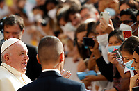 Pope Francis greets faithful as he arrives to attend his weekly general audience in St. Damaso courtyard at the Vatican, September 16, 2020.<br /> UPDATE IMAGES PRESS/Riccardo De Luca<br /> <br /> STRICTLY ONLY FOR EDITORIAL USE