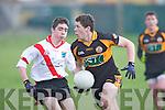 Austin Stacks Joe O'Kelly gets away from An Ghaeltacht's Fiach Ó Loingsigh at Connolly park, Tralee on Saturday.