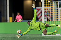 FOXBOROUGH, MA - SEPTEMBER 29: Sean Johnson #1 of New York City FC dives for a wide shot during a game between New York City FC and New England Revolution at Gillette Stadium on September 29, 2019 in Foxborough, Massachusetts.