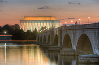 The Arlington Memorial Bridge spans the Potomac River leading to the Lincoln Memorial shortly before sunrise.