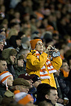 Blackpool 2 Liverpool 1, 12/01/2011. Bloomfield Road, Premier League. A home fan in the stands at Blackpool FC's Bloomfield Road stadium taking a photograph of the action during a match against Liverpool FC in the Premier League. The home side won by two goals to one in front of a crowd of 16,089. It was the first time the clubs had met in a league match since Blackpool were last in the top division of English football in 1970-71. Photo by Colin McPherson.