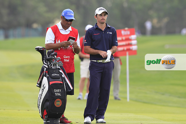 Gary Stal (FRA) and caddy Jason Jacobs prepare to play his 2nd shot on the 13th hole during Sunday's Final Round of the Abu Dhabi HSBC Golf Championship 2015 held at the Abu Dhabi Golf Course, United Arab Emirates. 18th January 2015.<br /> Picture: Eoin Clarke www.golffile.ie