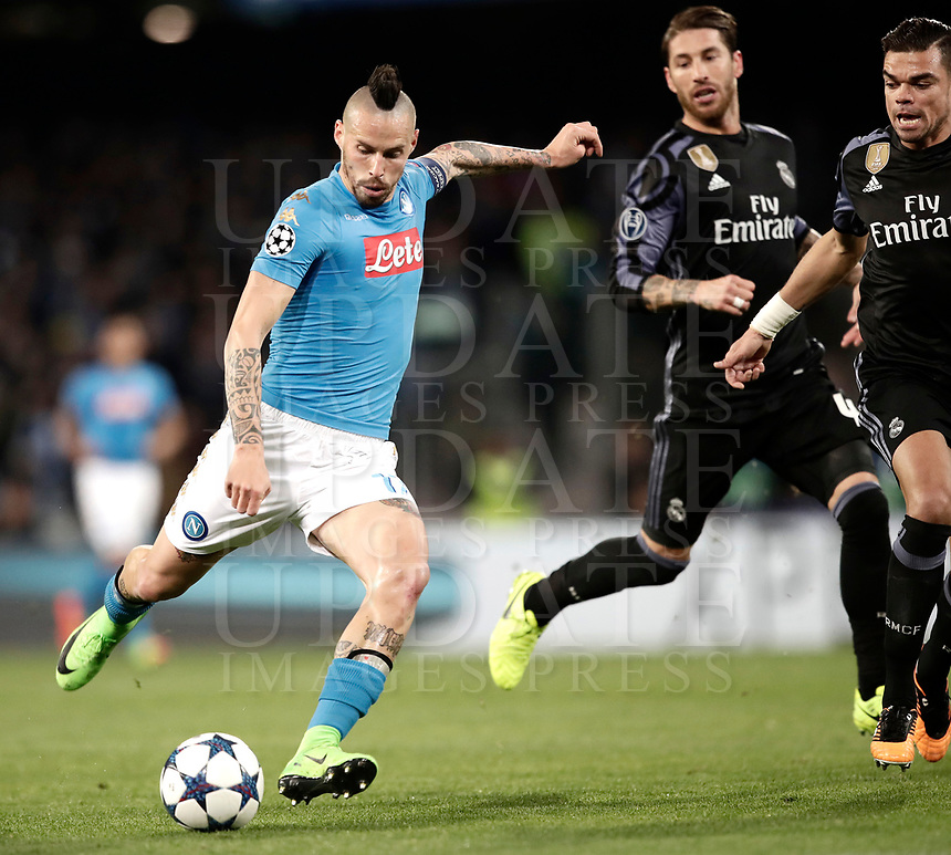 Football Soccer: UEFA Champions League Round of 16 second leg, Napoli-Real Madrid, San Paolo stadium, Naples, Italy, March 7, 2017. <br /> Napoli's Marek Hamsik (l) in action with Real Madrid's Sergio Ramos (c) and Pepe (r) during the Champions League football soccer match between Napoli and Real Madrid at the San Paolo stadium, 7 March 2017. <br /> Real Madrid won 3-1 to reach the quarter-finals.<br /> UPDATE IMAGES PRESS/Isabella Bonotto