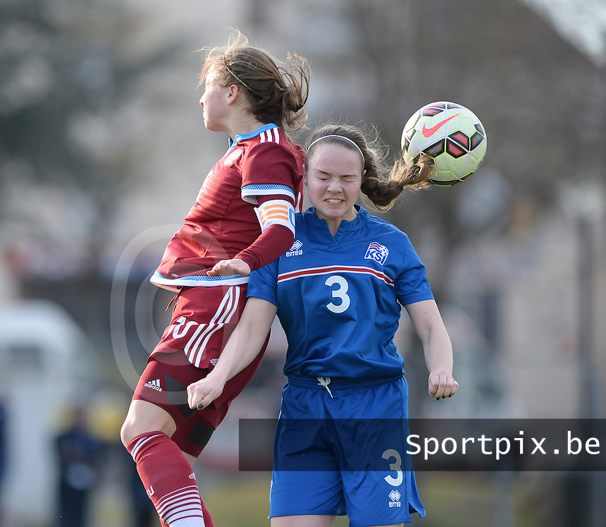 20150406 - MELUN , FRANCE  : Russian Margarita Chernomyrdina (10) pictured in a duel with Icelandic Anita Sol Agustsdottir (right) during the soccer match between Women Under 19 teams of Iceland and Russia , on the second matchday in group 3 of the UEFA Elite Round Women Under 19 at Stade Municipal , Melun , France . Monday 6th April 2015 . PHOTO DAVID CATRY