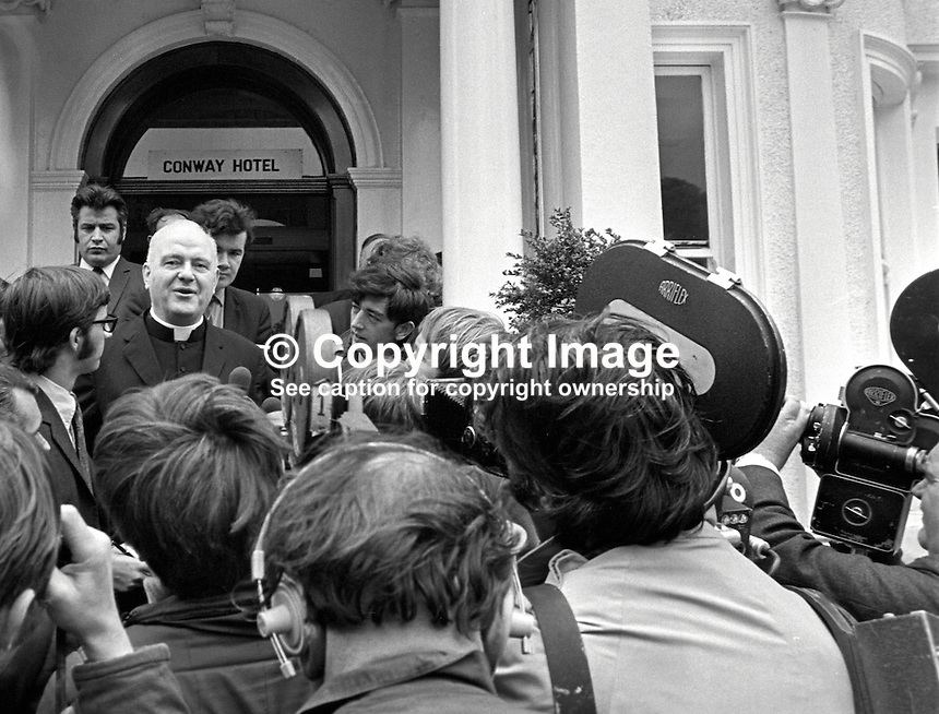 Cardinal Conway, Roman Catholic Archbishop of Armagh, Primate of All Ireland, is interviewed by journalists and television camera crews, following his meeting with UK Home Secretary, Reginald Maudling, who is on a two-day visit to N Ireland. 197007010241b.<br />