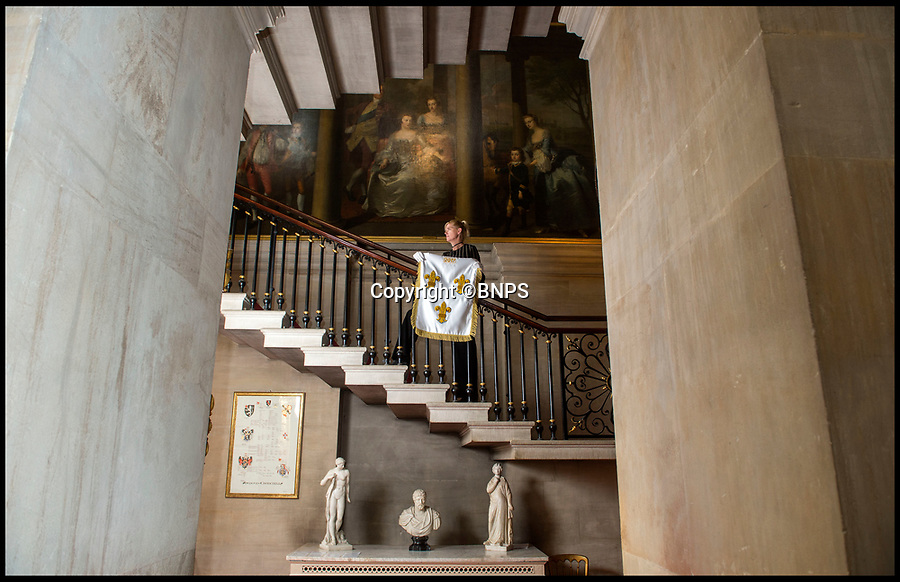 BNPS.co.uk (01202 558833)<br /> Pic: PhilYeomans/BNPS<br /> <br /> Blenheim house manager Kate Ballenger with the silk standard of Louis IVX...<br /> <br /> Blenheim Palace prepares to pay its Royal dues&hellip;.Historic standard of the 'Sun King' is presented annually to the Queen in lieu of rent.<br /> <br /> The 300 year old tradition will be upheld this week when officials from Blenheim Palace travel to Windsor Castle.<br /> <br /> Each year representatives of the Duke of Marlborough present a French royal standard to the Superintendent of the Castle in lieu of rent.<br /> <br /> Only Blenheim Palace and the Duke of Wellington's estate at Stratfield Saye are afforded the 'Quit rent standard' in thanks for their respective victories over the old enemy, France.<br /> <br /> Blenheim's standard is always presented in the week leading up to the anniversary of the First Duke&rsquo;s historic victory over Louis XIV at the Battle of Blenheim on August 13, 1704.<br /> <br /> Although Blenheim Palace was paid for by public subscription, the land it is on was a former Royal hunting lodge and in theory if the standards are not delivered the Queen could reclaim her former estate.