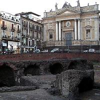 L'anfiteatro romano nel centro di Catania, .sullo sfondo la chiesa di San Biagio..The roman amphitheatre in Catania, .in background the church of San Biagio.