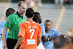 02 June 2012: Assistant Referee Ben Jackson (in green) separates Carolina's Austin da Luz (7) and Puerto Rico's Jonathan Fana (DOM) (right). The Carolina RailHawks defeated the Puerto Rico Islanders 2-1 at WakeMed Soccer Stadium in Cary, NC in a 2012 North American Soccer League (NASL) regular season game.