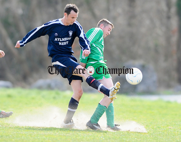 Rock Rovers  Ashley Glynn in action against Connolly Celtic's Michael Mc Guane during their 1st division game at Lees Road. Photograph by John Kelly.
