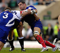 Twickenham, GREAT BRITAIN, French captain right, Rapheal IBANEZ, tackles Nick EASTER with the assistance of Pieter DE VILLIIERS, during the England vs France Six Nations Rugby International at Twickenham Stadium England on Sunday 11.03.2007,  [Photo Peter Spurrier/Intersport Images]