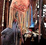 Close up- tapadero stirrups, chaps, and spurs. Santa Margarita, California