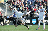 Maryland's Robbie Rogers (8) and New Mexico's Brandon Moss (7) fall to the ground while challenging for the ball. The University of Maryland Terrapins defeated the University of New Mexico Lobos 1-0 in the Men's College Cup Championship game at SAS Stadium in Cary, NC, Friday, December 11, 2005.