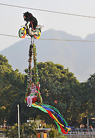 Asiatic brown bears are forced to ride a motobike at the end of a special event at Xili Safari Park, Shenzhen, China. The bears are forced to march, race bicycles, do gymnastics, wrestle, and even ride a motor-bicycle 20 meters above the crowd. ..PHOTO BY SINOPIX
