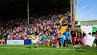 Lincoln City's Lee Frecklington leads his team-mates out onto the pitch<br /> <br /> Photographer Chris Vaughan/CameraSport<br /> <br /> The EFL Sky Bet League Two - Lincoln City v Swindon Town - Saturday 11th August 2018 - Sincil Bank - Lincoln<br /> <br /> World Copyright &copy; 2018 CameraSport. All rights reserved. 43 Linden Ave. Countesthorpe. Leicester. England. LE8 5PG - Tel: +44 (0) 116 277 4147 - admin@camerasport.com - www.camerasport.com