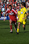 Gonzalo Segares, Chicago Fire and Guillermo Barros Schelotto, Columbus Crew race for the ball.