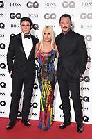 LONDON, UK. September 05, 2018: Richard Madden, Donatella Versace & Luke Evans at the GQ Men of the Year Awards 2018 at the Tate Modern, London