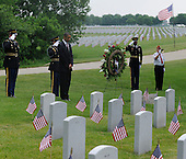 United States President Barrack Obama places a wreath at Abraham Lincoln National Cemetery in Elwood, Illinois on Memorial Day, Monday, May 31, 2010.     .Credit: David Banks / Pool via CNP