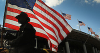 Kelly.Jordan@jacksonville.com--011612--A member of the Black Cowboys rides his horse carrying the American Flag during the annual Martin Luther King Jr. Day parade through downtown Monday January 16, 2012.(The Florida Times-Union, Kelly Jordan)