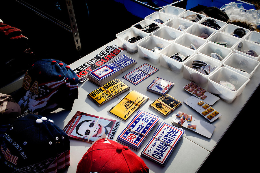 Denver, Colorado, March 31, 2010 - A table displaying  caps, stickers and pins for sale during Tea Party Express rally on the Capitol steps, the ninth in its 43-city tour across the country. Tea Party Express sponsors and team members who are travelling with the tour as guests, are helping to fund the trip by selling their books, CDs, pins, stickers, t-shirts and other materials. .