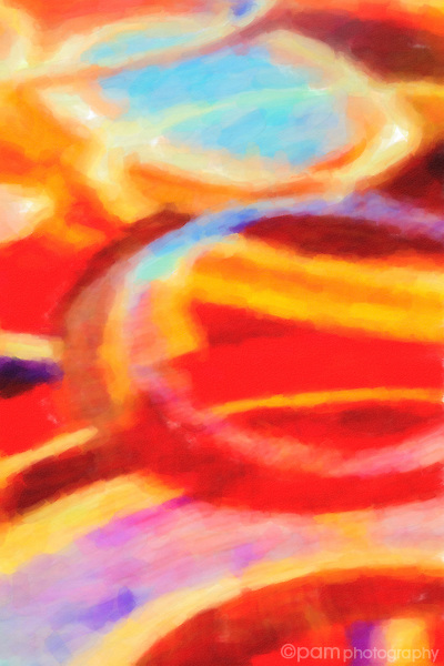 Colorful orange and red painterly abstract with circles.