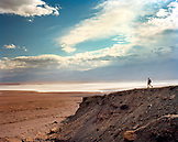 USA, California, Death Valley National Park, person hiking, Badwater Flats in distance