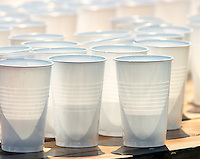 03 AUG 2003 -  LONDON, UK - Cups of water on a table at a drinks station during the London Triathlon. (PHOTO (C) NIGEL FARROW)