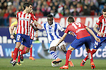 Atletico de Madrid's Augusto Fernandez (l) and Lucas Hernandez (r) and Real Sociedad's Bruma during La Liga match. March 1,2016. (ALTERPHOTOS/Acero)