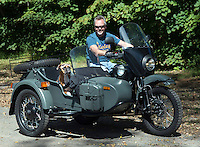 9/15/12 1:33:24 PM - Washington Crossing, PA.. -- A dog wears a pair of goggles while riding a Ural motorcycle with his owner at Washington Crossing State Park September 15, 2012 in Washington Crossing, Pennsylvania. -- (Photo by William Thomas Cain/Cain Images)