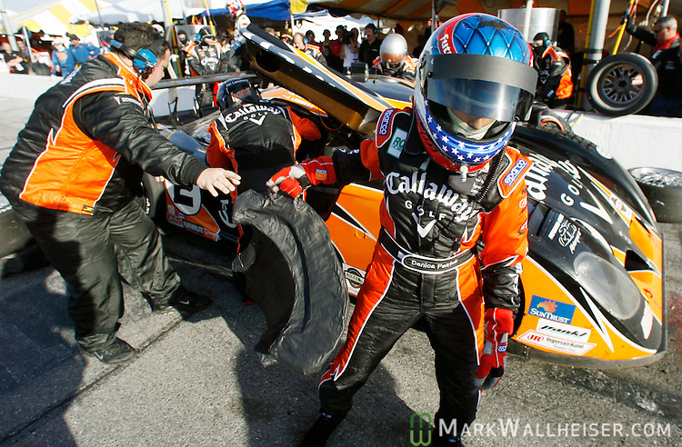 Driver Danica Patrick is handed her driving seat from one of her pit crew members as the drivers change is made with Jan Lammers of the Netherlands during the running of the Rolex 24 hour race at Daytona International Speedway in Daytona, Florida on January 28, 2006. Patrick shares driving duties on the Howard- Boss Motorsports Pontiac Crawford race car with Jan Lammers, Allan McNish of England and NASCAR legend Rusty Wallace.  REUTERS/Mark Wallheiser
