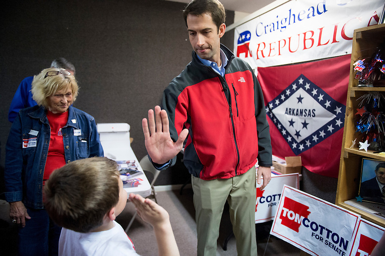 UNITED STATES - OCTOBER 30: Rep. Tom Cotton, Republican candidate for U.S. Senate challenging incumbent Sen. Mark Pryor, D-Ark., gets a high-five from a young supporter after speeaking to supporters at the Jonesboro Victory Office before helping phone bank to get out the vote on Thursday, Oct. 30, 2014 in Jonesboro, Ark. (Photo By Bill Clark/CQ Roll Call)