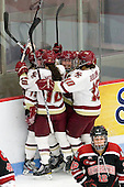 Emily Field (BC - 15), Ashley Motherwell (BC - 18), Alex Carpenter (BC - 5) and Blake Bolden (BC - 10) celebrate Field's goal. - The Northeastern University Huskies defeated the Boston College Eagles in a shootout on Monday, January 31, 2012, in the opening round of the 2012 Women's Beanpot at Walter Brown Arena in Boston, Massachusetts. The game is considered a 1-1 tie for NCAA purposes.