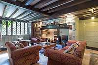 BNPS.co.uk (01202 558833)<br /> Pic: Strutt&Parker/BNPS<br /> <br /> A historic country home with links to the murder of Thomas Becket and a famous Noel Coward play has emerged on the market for £1.295million.<br /> <br /> Slaybrook Hall, near Saltwood, Kent, is where four of Henry II's knights reportedly hid after assassinating the saint at nearby Canterbury Cathedral in 1170.<br /> <br /> And playwright Noel Coward used it as the setting of his 1941 ghosty play Blithe Spirit.<br /> <br /> The six bedroom property's wooden decorative arches are thought to date from the 15th century, with a first floor and Tudor chimney added around that time.