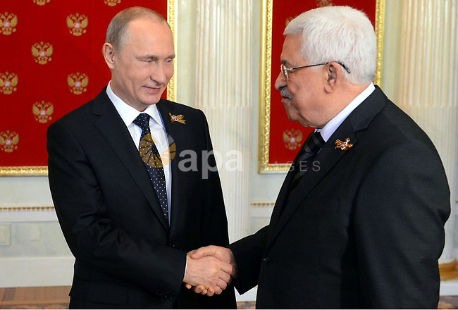 Russian President Vladimir Putin, left, welcomes Palestinian President Mahmoud Abbas during a ceremony in the Kremlin prior to the Victory Parade marking the 70th anniversary of the defeat of the Nazis in World War II, in Red Square, Moscow, Russia, Saturday, May 9, 2015. Photo by Thaer Ganaim