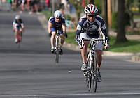 University of New Hampshire's Travis Mattison competes in the Men's D1 Criterium at the Eastern Collegiate Cycling Conference Championships on April 28, 2013. Mattison won the event. Photo/©2013 Craig Houtz