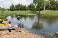 NWA Democrat-Gazette/CHARLIE KAIJO Jude Azzain, 4, of Tulsa, Okla. and Hannah Cicioni of Rogers (from left) skip rocks, Friday, July 5, 2019 at the Thaden field house dock across from Lake Bentonville Park in Bentonville. <br /> <br /> Lake Bentonville Park is undergoing a major renovation and will be closed July 8 through spring 2020