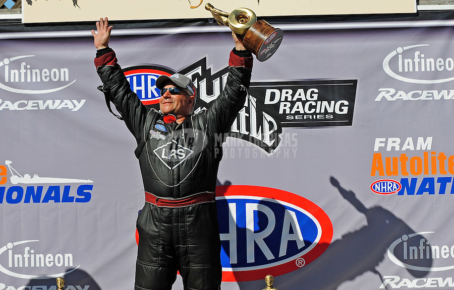 Jul. 26, 2009; Sonoma, CA, USA; NHRA funny car driver Tim Wilkerson celebrates after winning the Fram Autolite Nationals at Infineon Raceway. Mandatory Credit: Mark J. Rebilas-