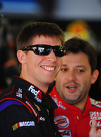 Apr 24, 2009; Talladega, AL, USA; NASCAR Sprint Cup Series driver Denny Hamlin (left) with Tony Stewart during practice for the Aarons 499 at Talladega Superspeedway. Mandatory Credit: Mark J. Rebilas-
