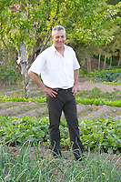 In the kitchen vegetable potager garden. Nikos Kontosoros, The owner. Kontosoros restaurant and guest house, Xino Nero, Amyndeo, Macedonia, Greece