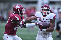 NWA Democrat-Gazette/J.T. WAMPLER Arkansas running back Devwah Whaley tries to shake defensive back Deon Edwards Saturday April 29, 2017 during a red-white scrimmage. The scheduled practice was closed to the general public and moved indoors because of thunderstorms.