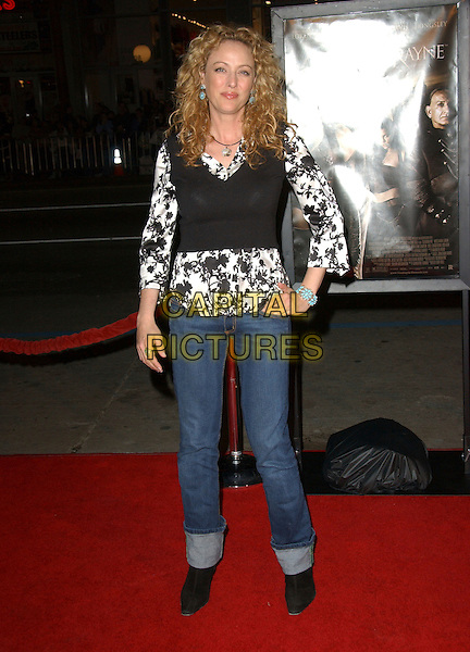 "VIRGINIA MADSEN.The L.A. Premiere of ""Bloodrayne"" held at The Grauman's Chinese Theatre in Hollywood, California, USA. .January 4th, 2006.Ref: DVS.full length jeans denim rolled up hand on hip black vest white pattern floral print shirt.www.capitalpictures.com.sales@capitalpictures.com.Supplied By Capital PIctures"