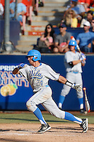 Brian Carroll #24 of the UCLA Bruins bats against the Cal State Fullerton Titans during the NCAA Super Regional at Goodwin Field on June 7, 2013 in Fullerton, California. UCLA defeated Cal State Fullerton, 5-3. (Larry Goren/Four Seam Images)