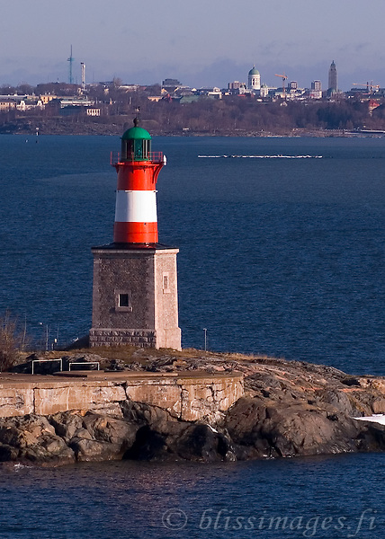 Harmaja Lighthouse with city of Helsinki in the distance -Gulf of Finland