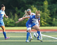 Boston Breakers forward Katie Schoepfer (12) attempts to control the ball as Sky Blue FC defender Kendall Johnson (5) pressures. In a National Women's Soccer League (NWSL) match, Boston Breakers (blue) defeated Sky Blue FC (white), 3-2, at Dilboy Stadium on June 30, 2013.