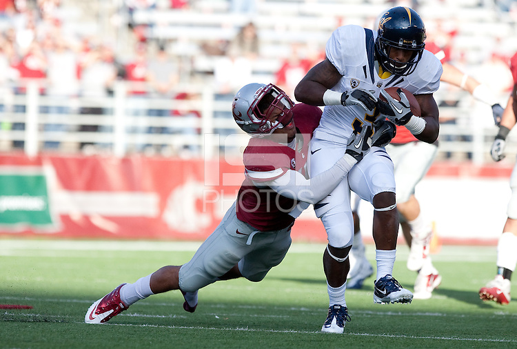Jeremy Ross carries the ball against Tyree Toomer. The University of California football defeated Washington State University 20-13 at Martin Stadium in Pullman, Washington on November 6th, 2010.