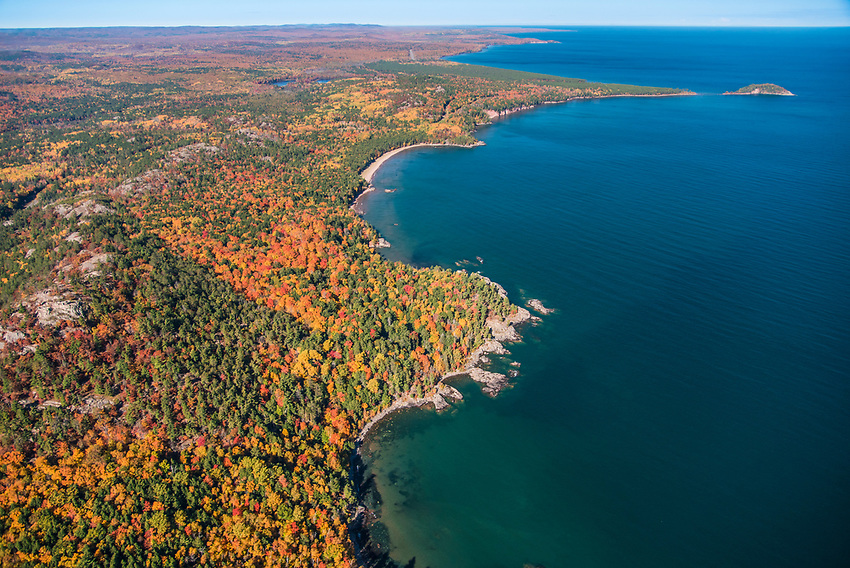 Aerial photography of the rugged Lake Superior shoreline north of Marquette, Michigan during fall color season. Areas shown include Little Presque Isle, Wetmore Landing Beach and Sugarloaf Mountain overlook.