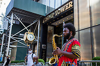 """NEW YORK, NY - JULY 9: Musicians perform next to the """"Black Lives Matter"""" mural in front of the Trump Tower in New York, NY on July 9, 2020. Bill de Blasio, Mayor of New York and founders of National Action Network Inc. (NAN) paints a """"Black Lives Matter"""" mural along Fifth Avenue across from the Trump Tower in New York. President Donald Trump criticized the mayor's plan to paint a street mural in front of Trump Tower. (Photo by Pablo Monsalve / VIEWpress via Getty Images)"""